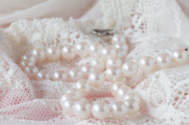 White delicate lace fabric and pearls