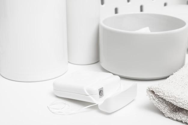 White dental floss on bathroom table