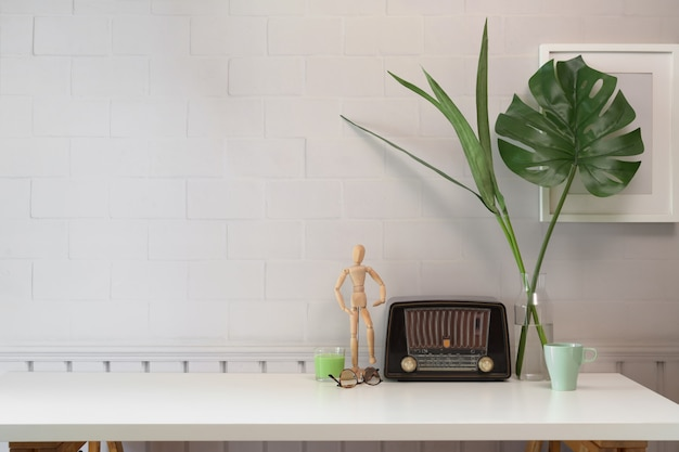 White desk table with vintage radio and copy space