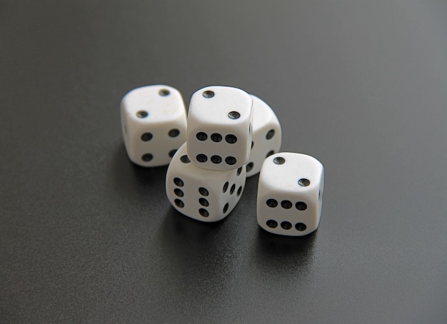 White dice on an even background