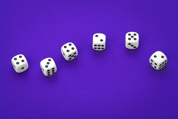 White dices against a blue
