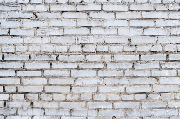 Белая грязная гранж кирпичная стена