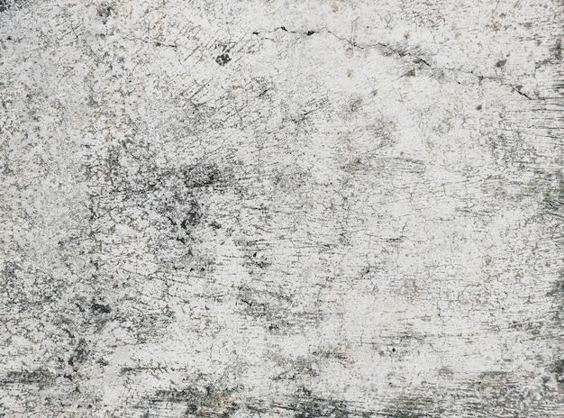 Белый грязный деревенский бетонный пол