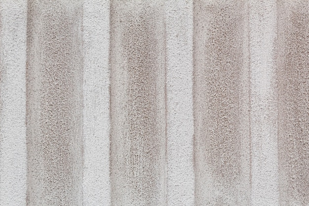 White dirty textured concrete wall in close-up, textured background