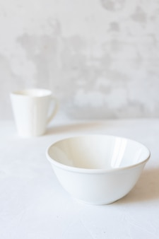 White dishes on a concrete surface