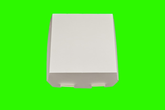テキストのための場所と緑の背景に食品配達のための白い使い捨て段ボール箱