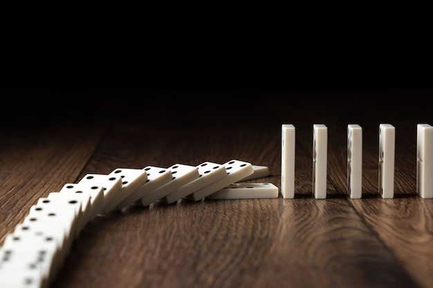 White domino on brown wood