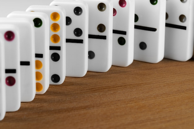 White domino dice on a wooden table