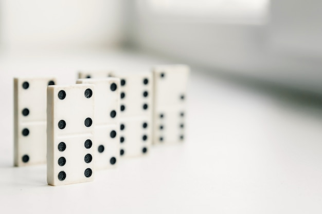 White domino, domino principle, on white background