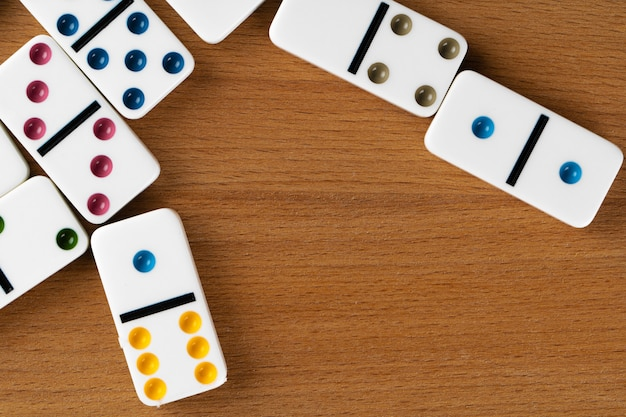White domino pieces on a wooden table