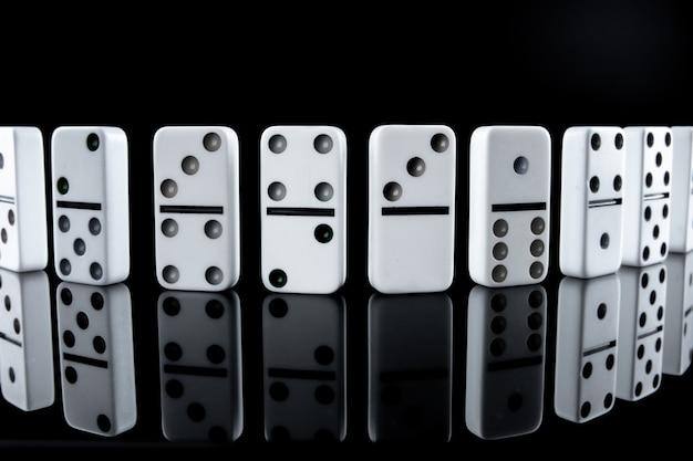White dominoes in the dark