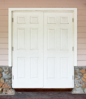 White door with the wall