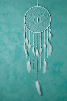 White dream catcher on aquamarine