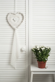 White dream catcher with flowers