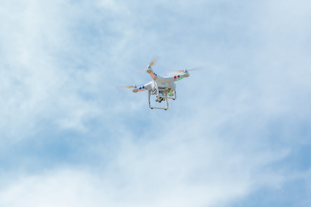 White drone hovering