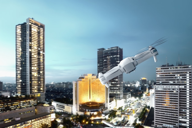 White drone with camera flying above modern city with skyscrapers