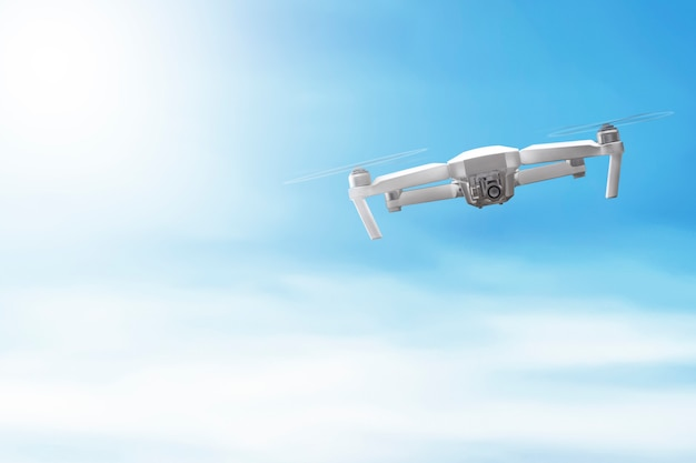 White drone with camera flying