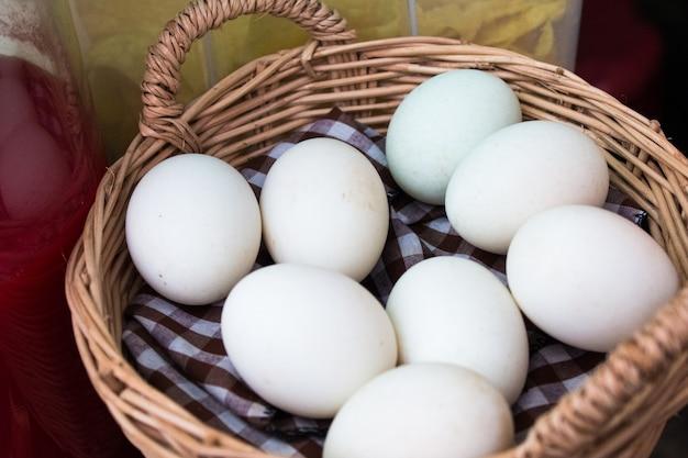 White duck eggs in basket