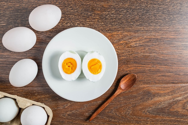 White duck eggs and salted egg food on a wooden table