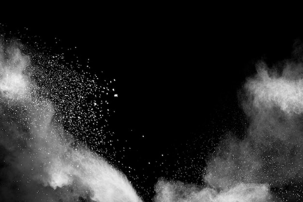 White dust particles exhale in the air.