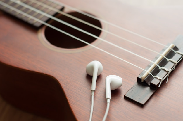 White earphone on ukulele