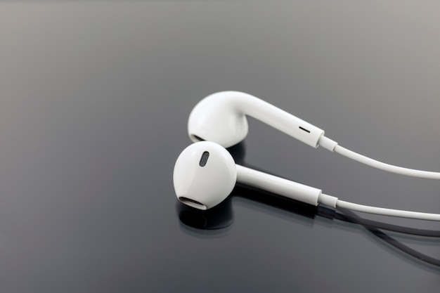 White earphones on black background