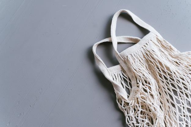 White eco cotton net shopping bag on gray