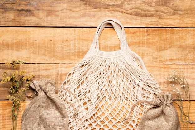 White eco friendly bag on wooden background