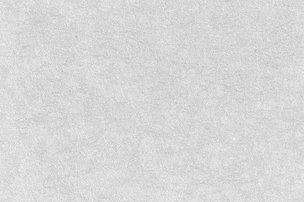 ホワイトエコリサイクルクラフト紙シートテクスチャ段ボールの背景。