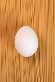White egg on the raw pasta