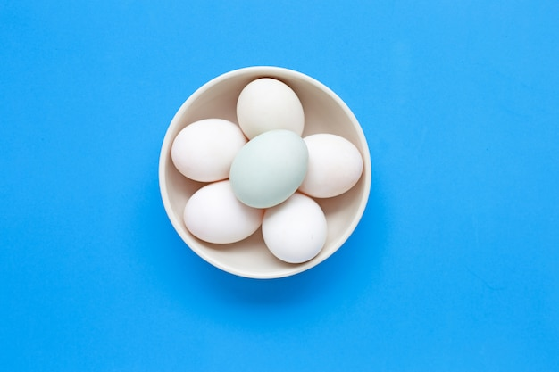 White eggs on blue background.