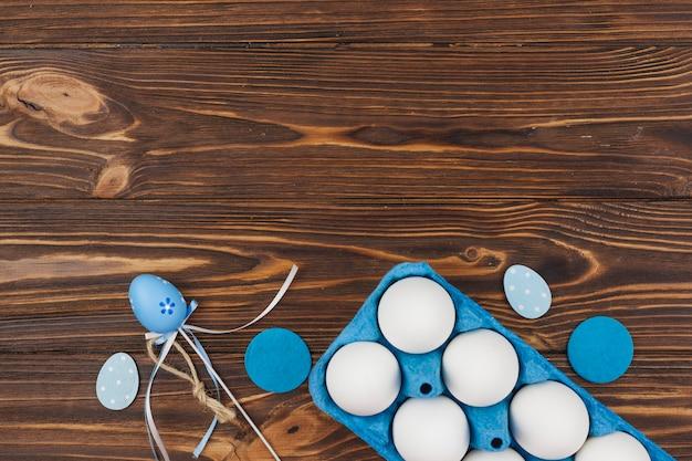 White eggs in blue rack on table