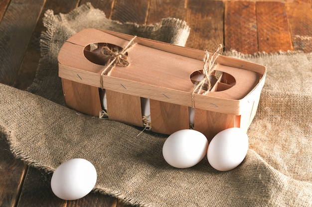 White eggs in an eco-friendly wooden packing box