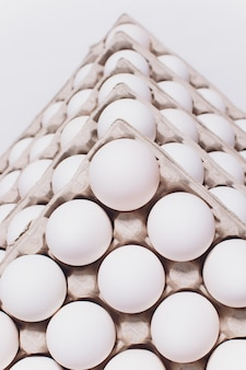 White eggs of a hen in harmless, cardboard packing