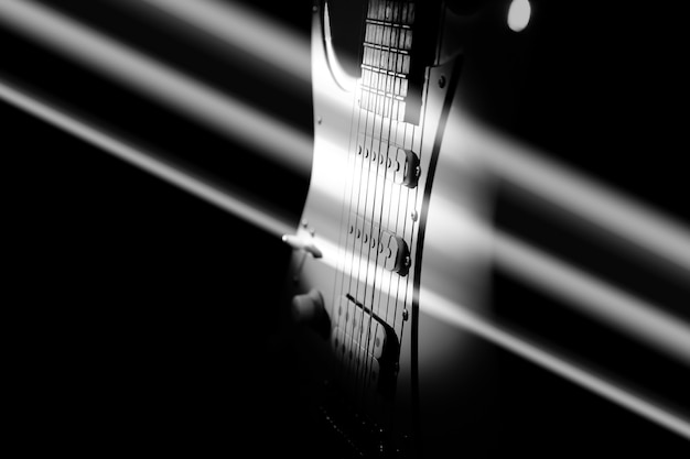 White electric guitar. music concept. creative style with light shadows.