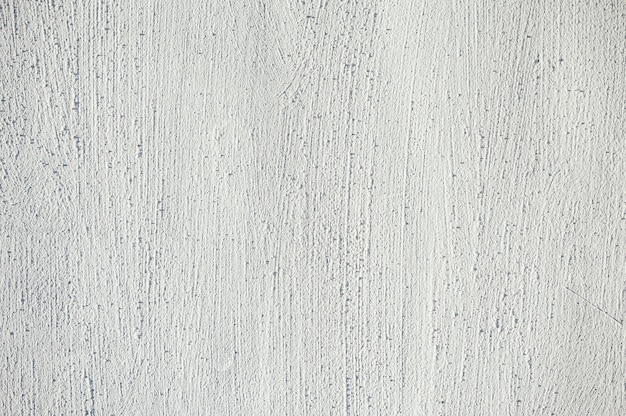 White embossed texture of the painted wall. pattern.