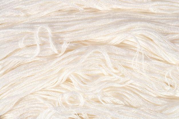 Белая вышивка мулине в качестве фоновой текстуры