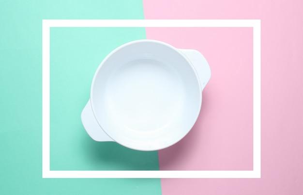 White empty bowl on pastel color