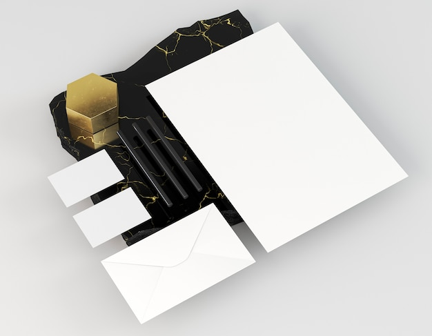 Documenti cartacei vuoti bianchi su roccia di marmo elegante
