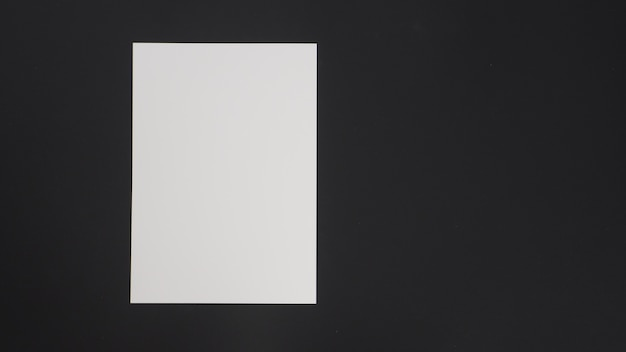 White empty space a4 paper put on black background.