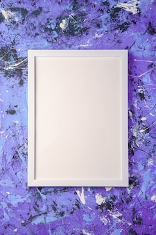 White empty template picture frame on textured blue and purple surface, top view, mockup copy space