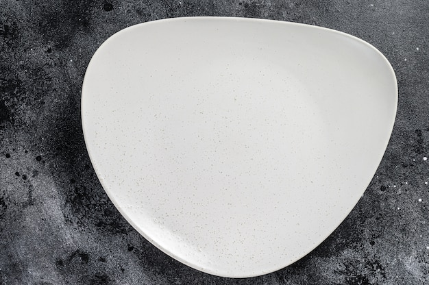 White empty triangular plate, restaurant background. top view. copy space