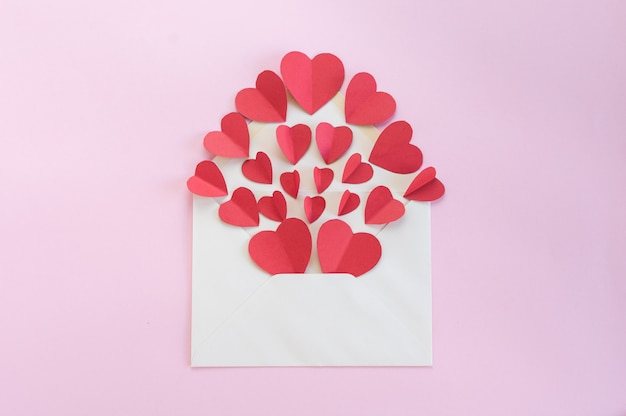 White envelope full of hearts