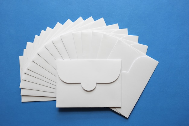 White envelope letters on blue background