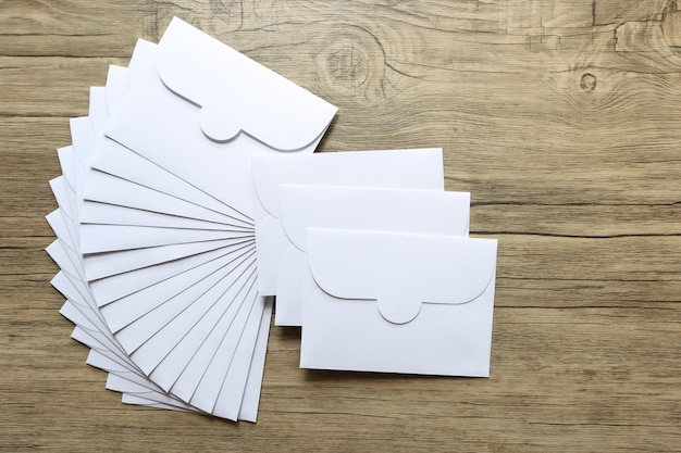 White envelope letters on wooden background