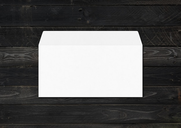White envelope mockup template isolated on black wood
