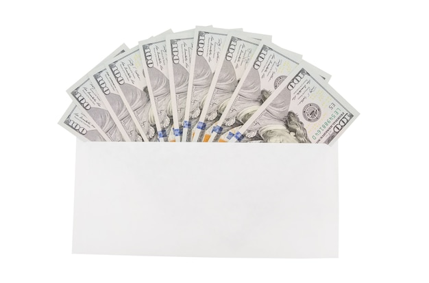 White envelope with dollars on a wooden background. financial concept.
