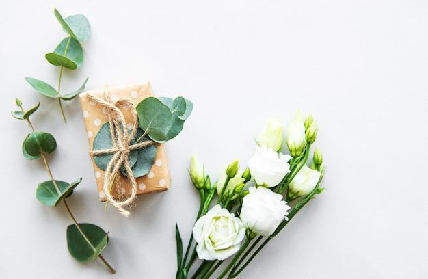 White eustoma flowers and gift box