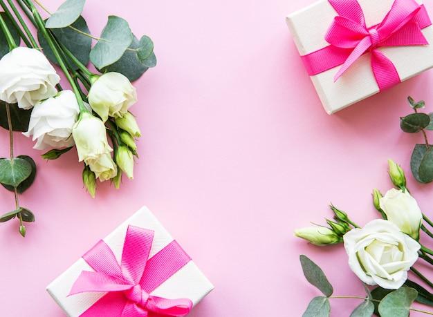 White eustoma and gift boxes