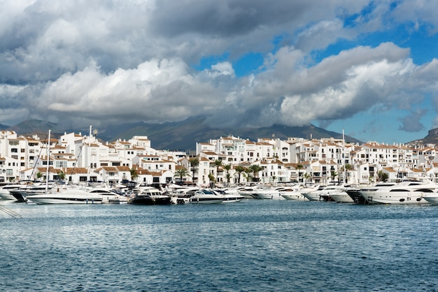 White expensive luxury yachts moored in the marina of puerto jose banus on the costa del sol.